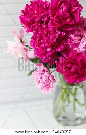 Bouquet of pink peonies in vase