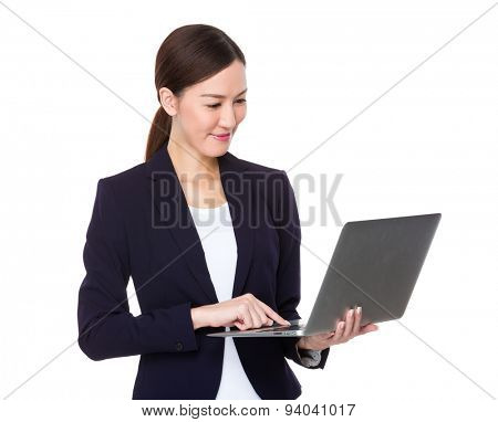 Asian businesswoman type on the notebook computer