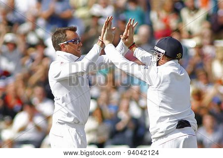 CHESTER LE STREET, ENGLAND - August 11 2013: Graeme Swann and Ian Bell celebrate the wicket of Brad Haddin during day three of the Investec Ashes 4th test match at The Emirates Riverside Stadium