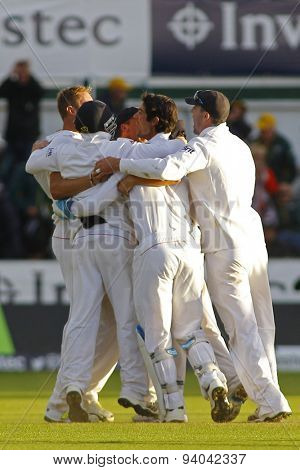 CHESTER LE STREET, ENGLAND - August 12 2013: England players celebrate winning the match and winning the Ashes during day four of the Investec Ashes 4th test match at The Emirates Riverside Stadium