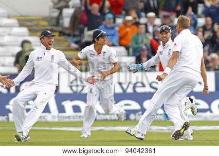 CHESTER LE STREET, ENGLAND - August 12 2013: Graeme Swann, Alastair Cook, Matt Prior and Stuart Broad celebrate the wicket of Michael Clarke during day four of the Investec Ashes 4th test match