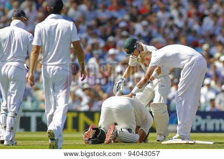 LONDON, ENGLAND - August 21 2013: Stuart Broad and Michael Clarke check on Shane Watson after he was hit on the head during day one of the 5th Ashes cricket match between England and Australia