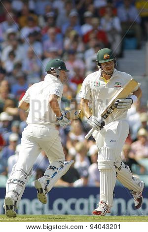 LONDON, ENGLAND - August 21 2013: Michael Clarke and Shane Watson run a single during day one of the 5th Ashes cricket match between England and Australia played at The Kia Oval Cricket Ground