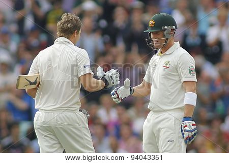 LONDON, ENGLAND - August 22 2013: Steven Smith is congratulated by Brad Haddin after scoring his maiden century during day two of the 5th Investec Ashes cricket match between England and Australia