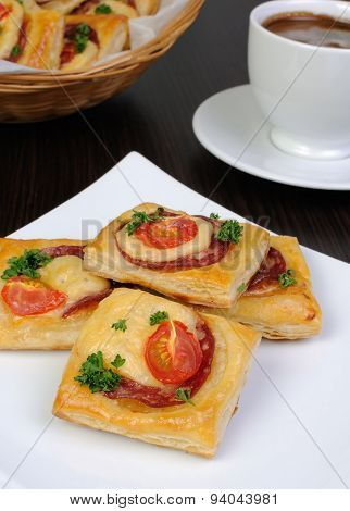 Appetizer Of Puff Pastry With Salami