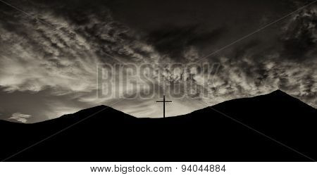 Beautiful Silhouette Image of a cross on top of a Mountain on the mexican Border