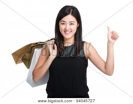 Woman hold with shopping bag and thumb up