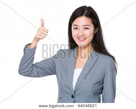Businesswoman with thumb up gesture