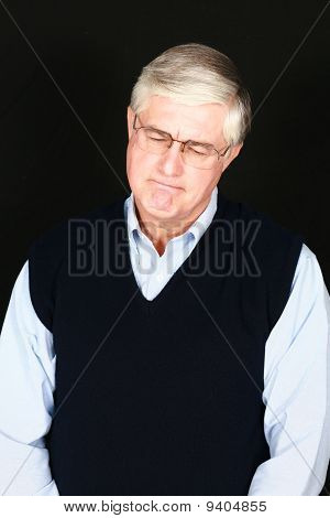 Sad Mature Man With Silver Hair