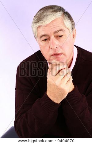 Sad Mature Man With Grey Hair