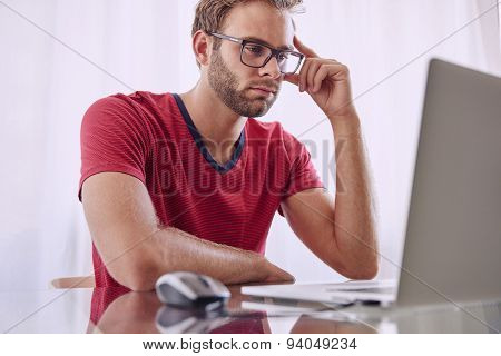 Young professional busy concentrating to solve a problem