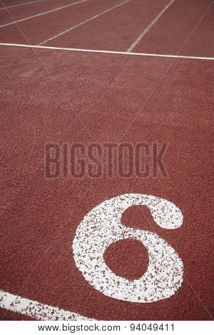 Number Six Signpost In An Athletic Running Track