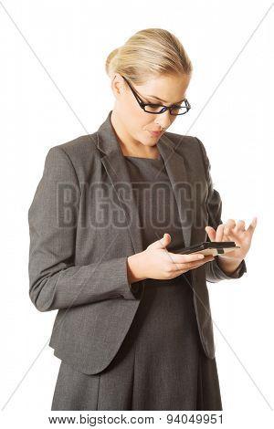 Beautiful businesswoman sending a message