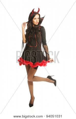 Full length devil woman standing with bended knee.
