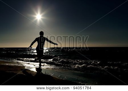 The image of people at sunset, view of a silhouette