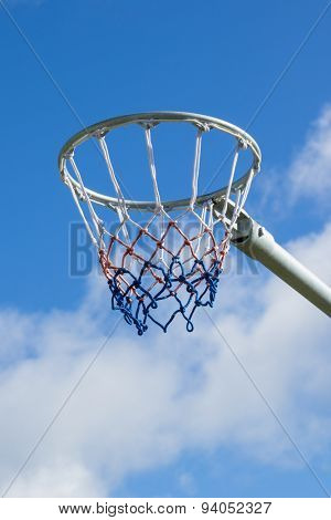 Netball hoop against blue sky