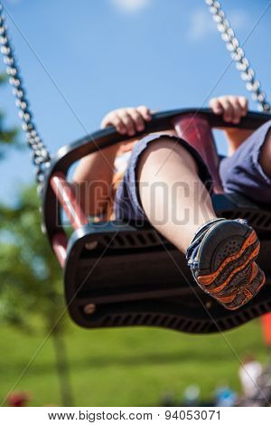 Child On The Swing