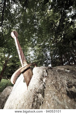 Excalibur The Famous Sword In The Stone Of King Arthur In The Forest