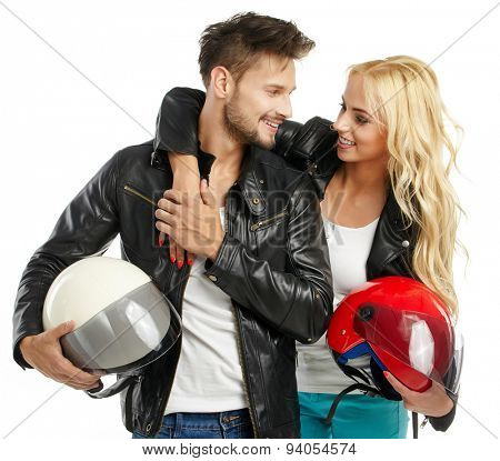 motorcyclists couple with helmets in hand