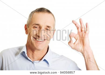 Mature man showing perfect sign.