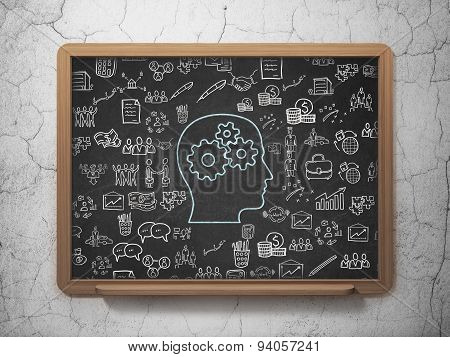 Finance concept: Head With Gears on School Board background