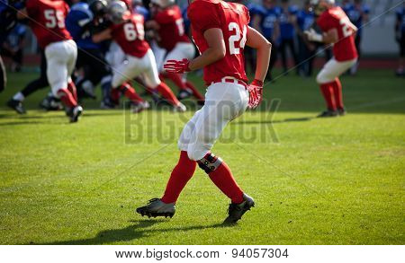 american football game with out of focus players in the background - sports concept,