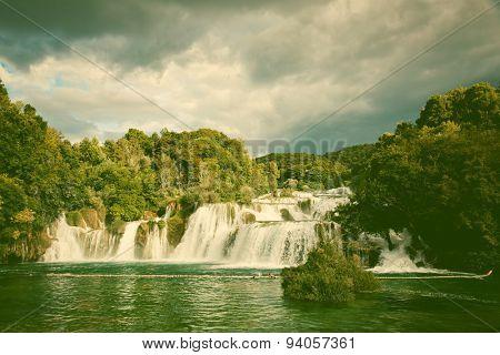 Beautiful long exposure panorama of waterfalls of the Krka river in Krka national park in Croatia - retro style postcard