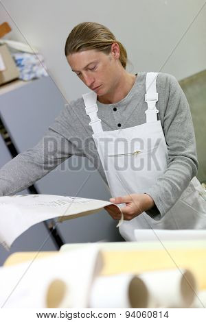 Painter looking at decoration plan