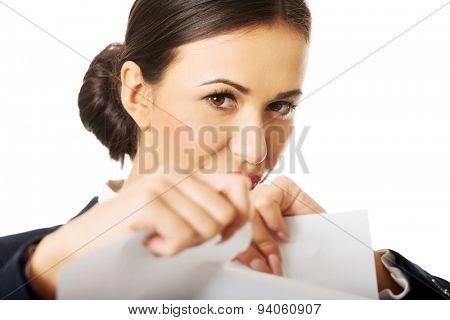 Portrait of businesswoman tear her paper notes.