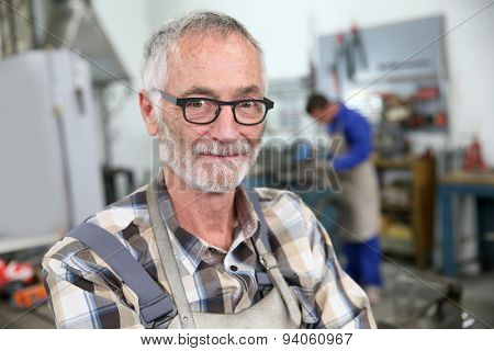Portrait of smiling senior ironworker