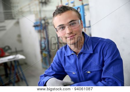 Portrait of smiling young trainee in plumbing sector