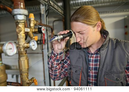 Plumber controling water quality from heater
