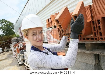 Young apprentice working on construction site