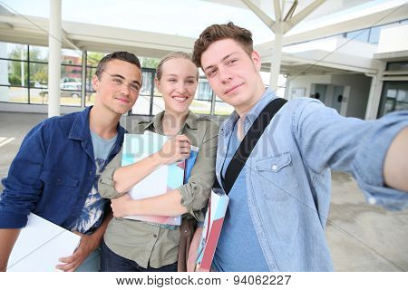 Students taking selfie picture in school campus