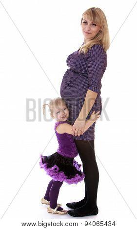 Cute little girl hugging your favorite pregnant mom