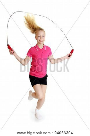 Teenage girl jumping rope