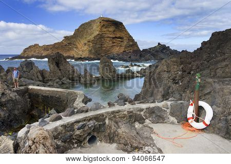 Swimming natural pools of volcanic lava in Porto Moniz, Madeira island, Portugal, Europe
