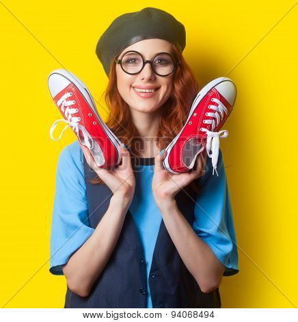 Smiling Redhead Girl With Red Gumshoes