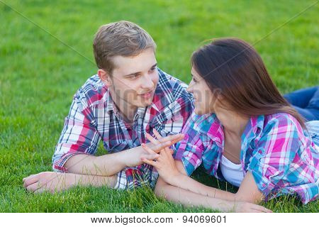 Young Teen Couple On The Green