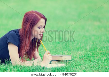 Girl In Indie Style Clothes With Books