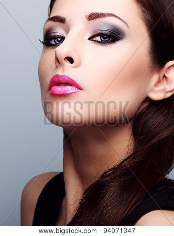Beautiful Woman With Bright Smokey Makeup Eyes And Pink Lipstick. Perfect Closeup Make-up
