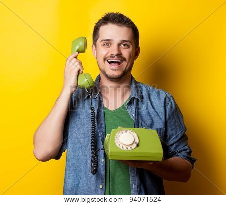 Guy In Shirt With Green Dial Phone