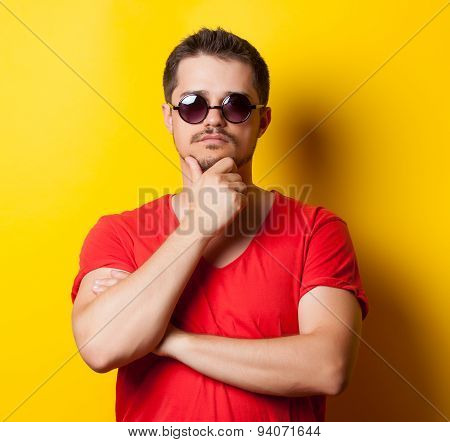 Young Guy In T-shirt With Sunglasses
