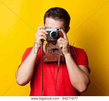 Guy In T-shirt With Retro Camera