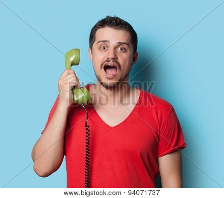 Guy In T-shirt With Green Retro Dial Phone