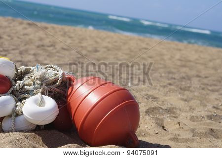 Buoy On The Beach.