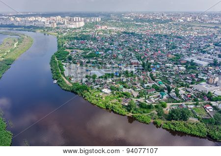 Disrict of private houses on bank of river. Tyumen