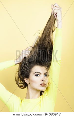 Portrait Of Woman Combing Hair