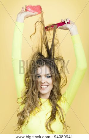 Portrait Of Cute Lady With Hair Brushes
