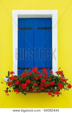 Colorful window on the wall, Burano, Venice, Italy